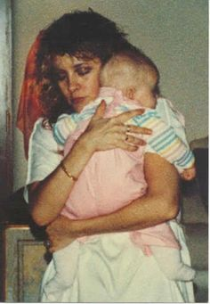 Stevie Nicks taking care of the baby after Robin passed (why is the baby dressed in pink if that is Matthew?)