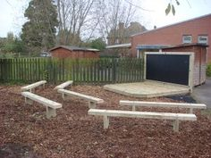 Timber Stage and Seats with Chalk Board. Outdoor Stage, Outdoor Play, Outdoor Decor, Web Design, Deck, Playground Ideas, Play Ideas, Plants, Home Decor