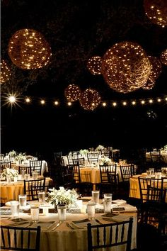 I love the chandelier balls over the tables