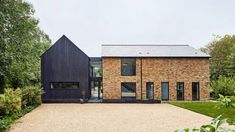 Napier Clarke Architects has renovated a 1970s house in Buckinghamshire, England, adding a glazed entrance link and converting the former garage into a kitchen clad in charred timber. Garage Extension, London Brick, 1970s House, Basin Design, Melbourne House, Timber Cladding, The Gables, Ground Floor Plan, Brick Building
