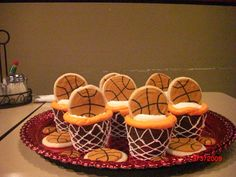 basketball cupcakes for my son's end of yr party - The basketballs are sugar cookies with royal icing.  The cupcakes were the extra large cupcakes.  I don't think it would look the same if you used regular sized cupcakes.