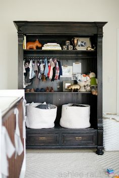 Armoire in baby room. Use for clothes, toys, and decor. Great storage for small spaces & small things.