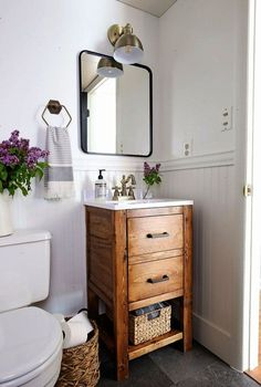 A small bathroom is made over into a classic modern rustic bathroom on a budget! Check out the before and after photos! Powder Room Ideas | Budget Bathroom Makeover