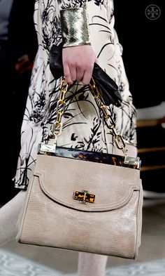 4bb3440a5264 The Tory Burch Lizard resin top bag instantly dresses up a casual day look  or perfectly