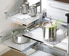 Hettich moving corner - kitchen corner cabinet solutions CN-I've decided on this versus the others, but this one I like because it does not have wire base (harder to keep clean). Kitchen Corner Cupboard, Kitchen Cabinet Styles, Kitchen Cabinets, Kitchen Appliances, Corner Cabinets, Corner Cabinet Solutions, Kitchen Storage Solutions, Kitchen Organization, Buy Kitchen