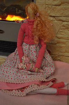 Con su suéter tejido y calentadores