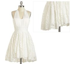 Channel Marilyn Monroe in this flouncy halter-neck dress, with a soft lace overlay. $72.99  More options: http://www.littlevegaswedding.com/2013/04/budget-short-wedding-dresses-for-vegas/