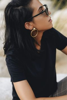 Chunky gold hoops of fashion blogger Tania Sarin