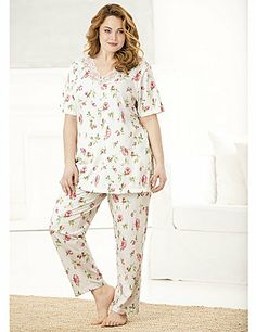 """Allover floral with lacy trim at the V-neckline of the pullover top. Short sleeves, side vents at hem. Comfortable pull-on pants with all-around elasticized waist. Relaxed fit.  95% cotton/5% spandex. Machine wash. Imported. Length: Top 30"""", Pants inseam 30"""". catherines.com"""