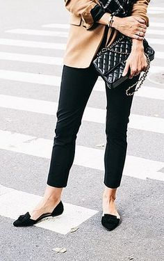 Cropped trousers, modern loafers, and a quilted purse