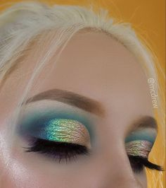 Turquoise, deep blue, peacock eye makeup