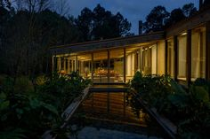 Casa Santana is a space for people to come together, made of wood and other local materials, that blends with the lush Mexican natural landscape.