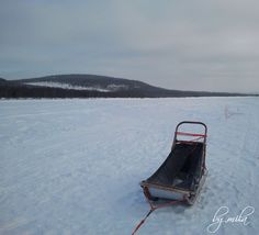 Sled on a frozen river -  Arctic Circle