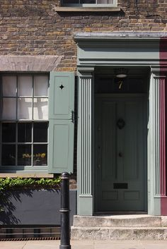 7 Fournier Street, Spitalfields, London Farrow and Ball green smoke, grey green colour. Exterior Door Colors, House Paint Exterior, Exterior Doors, Georgian Interiors, Georgian Homes, Green Windows, Windows And Doors, Outdoor Paint, House Front