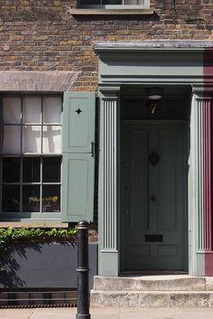 7 Fournier Street, Spitalfields, London (c.1722) restored.Paintwork is Farrow and Ball green smoke, a lovely grey green colour.