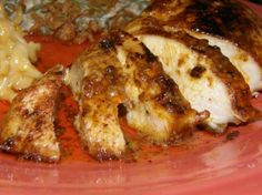 """Chicken Lazone... An AMAZING chicken recipe!!! This recipe uses many items you most likely already have on hand. The only change I make for this recipe is that I cut the uncooked chicken in to 2"""" pieces, instead of leaving the breasts whole, in order to achieve even cooking. The chicken is coated with a 'rub' consisting of chili powder, onion powder, garlic powder, and salt. It is then sauteed in butter, cream is added, and then a bit more butter. Yes, I know, it's completely unhealthy...but ..."""