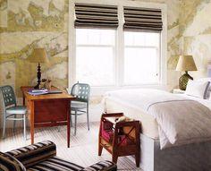 vintage map wallpaper, blue chairs, vintage wood desk, striped roman shades.  Steven Gambrel.