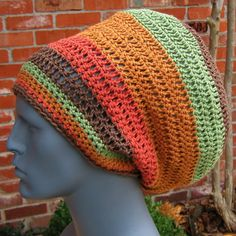 This is a long and very wide dread tam hat in muted rasta colors or faded b60b8ec2aba9