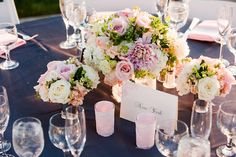 Light pink, peach, ivory, lavendar, and light green floral table centerpiece with ivory table card with pink whimiscal design designating table by New York City -  wedding photo by Michael Norwood Photography