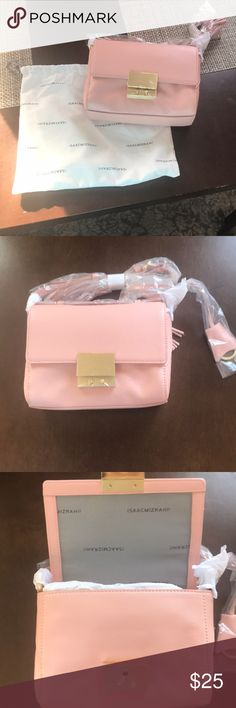 Isaacmizarahi small light pink purse Isaacmizrah light pink purse still in package. I received it as a gift but It's not my style. Brand new. Non smokers Home. Perfect condition. Bags