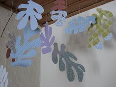 Matisse:  A fun DIY project, this girl made a large scale leaf cut out mobile. What pretty paper she used.