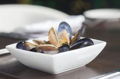 Black Lip Mussels steamed in white wine and garlic cream sauce with warm crusty bread