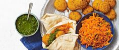This recipe for sweet potato falafel with coriander chutney and carrot salad is vegan, low-calorie and gluten-free. Plus, it's ready in under an hour - perfect for midweek