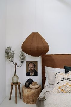 A white bedroom with dark brown linen headboard and pendant lamp and a wood stool. A white bedroom with dark brown linen headboard and pendant lamp and a wood stool. Modern Bedroom, Bedroom Decor, Bedroom Vintage, Bedroom Ideas, Linen Headboard, Headboard Ideas, Linen Bedroom, Master Bedroom, Scandinavian Bedroom