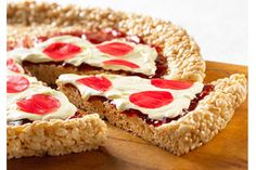 Rice Krispie Pizza - red jelly for sauce, white icing for mozzarella, cut up fruitrollups for pepperoni... could add other candies for other veggies.