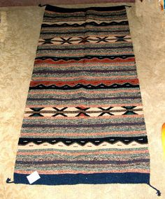 "A quality woven rug in subtle earthtones. 32x64"" with tassled corners. Durable acrylic fibers. $79.95 w/ free shipping! #rug #throwrug #homedecor #earthtones"