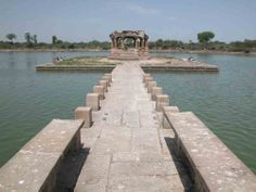 Malav Tank, Dholka, Ahmedabad.  It was constructed during the reign of Siddharaja Jaya Simha. It was dedicated to his mother Minal Devi. The tank is surrounded by flights of steps and ghats. From the village one can reach the centre of the tank through a stone bridge where ruins of temples are seen.