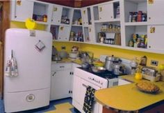 1950s kitchen...I don't care for the slanted cabinets, but the colors are nice.  Hubby's favorite color is yellow!