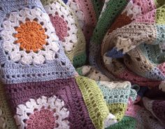 Delightful colours in this blanket by prairie mouse on flickr. It uses Chris Simon's Flower Burst square pattern: http://www.yarncrazy.com/flower-burst
