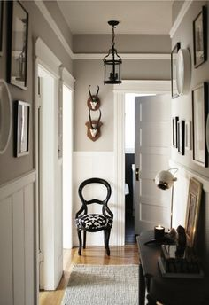 Days: Inspiring Silver Rooms grey walls with white wainscoting - I could do without the more rustic elements, but everything else I love.grey walls with white wainscoting - I could do without the more rustic elements, but everything else I love. Wainscoting Hallway, Wainscoting Styles, Wainscoting Nursery, Wainscoting Kitchen, Wainscoting Height, Painted Wainscoting, Wainscoting Panels, Black Wainscoting, Hallway Wallpaper