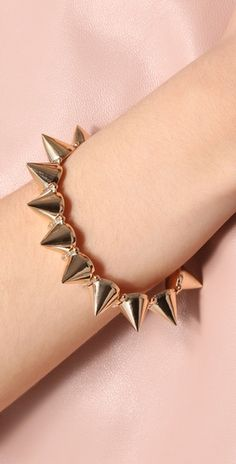 So your kids no Mercy with this Gold Spike Bracelet...