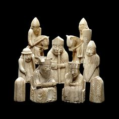 The Lewis Chessmen: The chess pieces consist of elaborately worked walrus ivory and whales' teeth in the forms of seated kings and queens, mitred bishops, knights on their mounts, standing warders and pawns in the shape of obelisks.