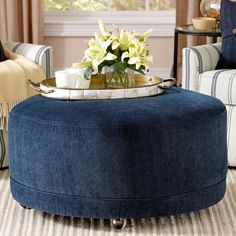 Clean lines and a wheeled base for easily mobility make this ottoman a classy update to your living space.