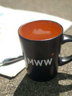 We love our new coffee mugs with our new company colors! #orange