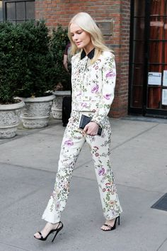 Kate Bosworth in a Giambattista Valli floral print suit, black strappy sandals and leather clutch.