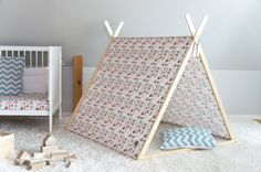 A tent will increase the playground of the child's imagination and form the perfect environment for the child's own fantasy world and playing. The tent may be used indoors, in the garden or even the beach - any dry place of your choice.  The A-shaped tent will take a place in your home and the hearts of your children. The tent frame without the fabric and with the set of battens provided can be transformed into a clothes hanger for the child. The clothes hanger frame may be ordered…