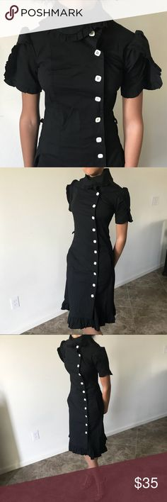Black Shabby Apple Mid Length Dress. Pre-Owned Black Shabby Apple Midi Length Dress. This dress is trimmed in ruffles, has a high neck, off white buttons and pockets. Missing a button at the bottom but not noticeable. Please ask questions. Shabby Apple Dresses Midi