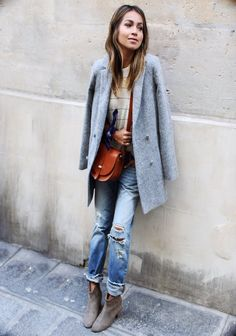 Julie Sarinana wears ripped denim jeans with a mar grey overcoat and cute suede ankle boots. Tee: Madewell. Jeans: Levi's, Boots: Isabel Marant, Coat: Sezane. 11am
