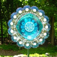 Hand painted depression glass egg plate, with a crystal plate edged in hobnail, blue glass candy dish and candle holder accented in glass gems.