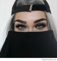Grey hair and blue eyes
