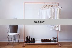 * SOLD OUT * This copper clothing rack features a Carrara marble shelf along the bottom. The 3/4 thick slab of marble is hefty, the same thickness