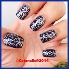 Swirl nail art using Essie under the twilight stamped with Mother Nature 01
