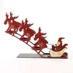 XMAS-HS-132 Metal Santa on a Sleigh Tealight Holder (360 MXN) ❤ liked on Polyvore featuring home, home decor, christmas and metal home decor