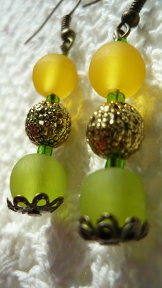 yellow-green plastic beads and metal