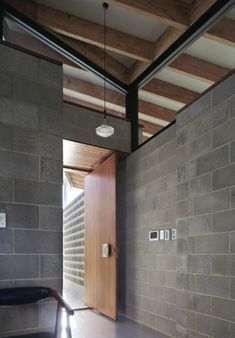 In the Concrete House by Fringe Architects, the concrete and breezeblock entry is a tribute to Iwanoff, photo by Robert Firth. Office houses design plans exterior design exterior design houses home architecture house design houses Masonry Blocks, Concrete Masonry Unit, Concrete Block Walls, Concrete Bricks, Concrete Houses, Cinder Block House, Cinder Block Walls, Brick Architecture, Interior Architecture