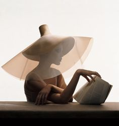 Vogue, July 2004. Yohji Yamamoto straw hat with clear plastic overlay. Photographed by Irving Penn. #passion4hats